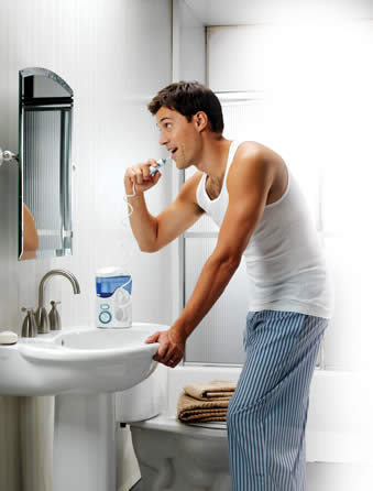 Man-Using-Water-Flosser